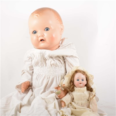 Lot 100-A German bisque head doll, fixed eyes,  open mouth, composition jointed body; and another composition doll.