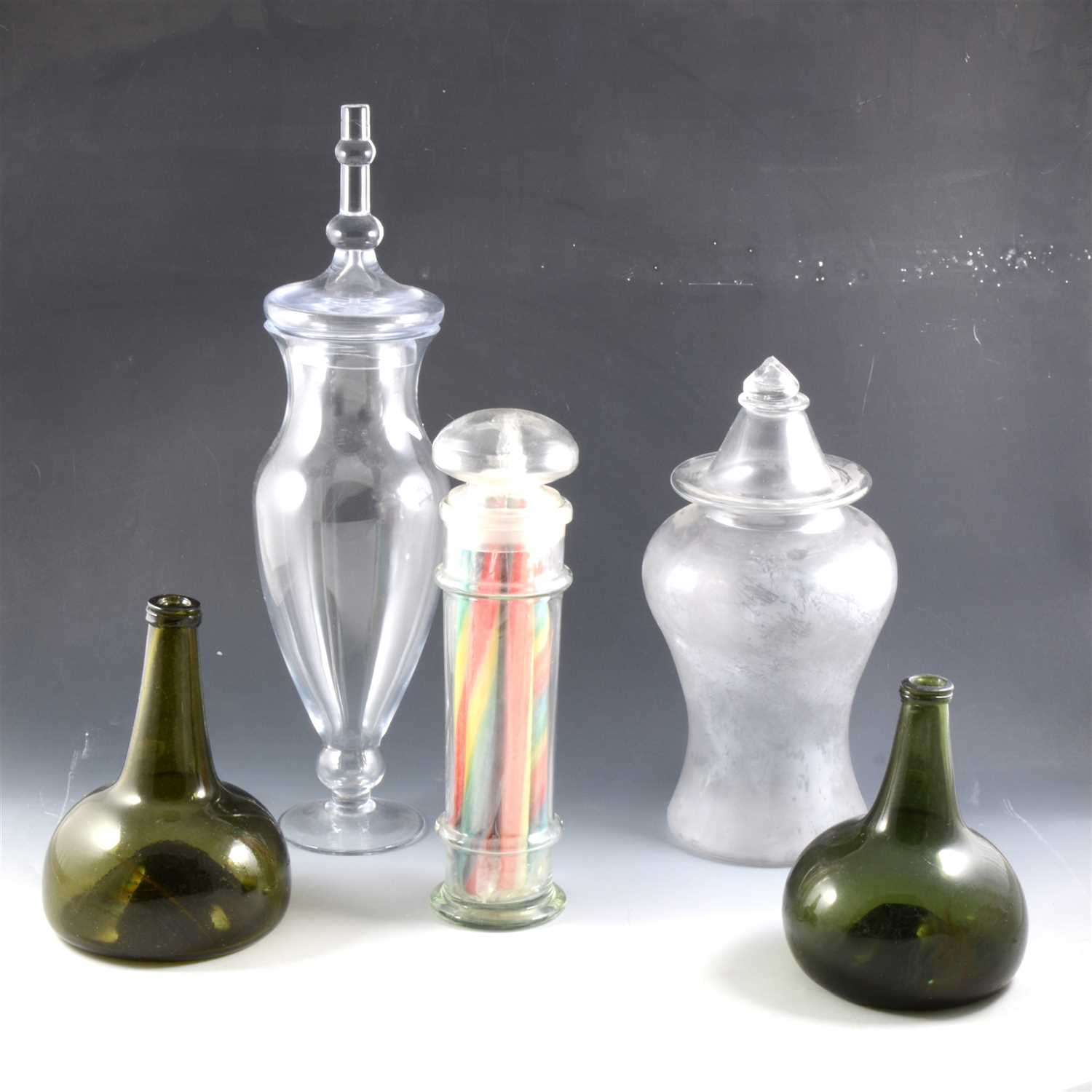 Lot 46-Two olive green glass onion-shape decanters, and three glass jars