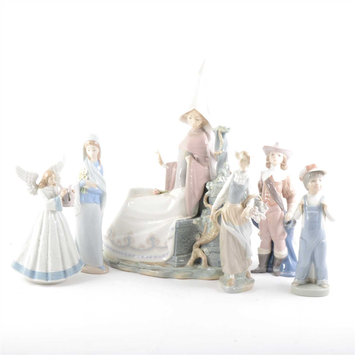 Lot 20-A large Lladro figure, of a lady in a tall hat, and five other Lladro figures.