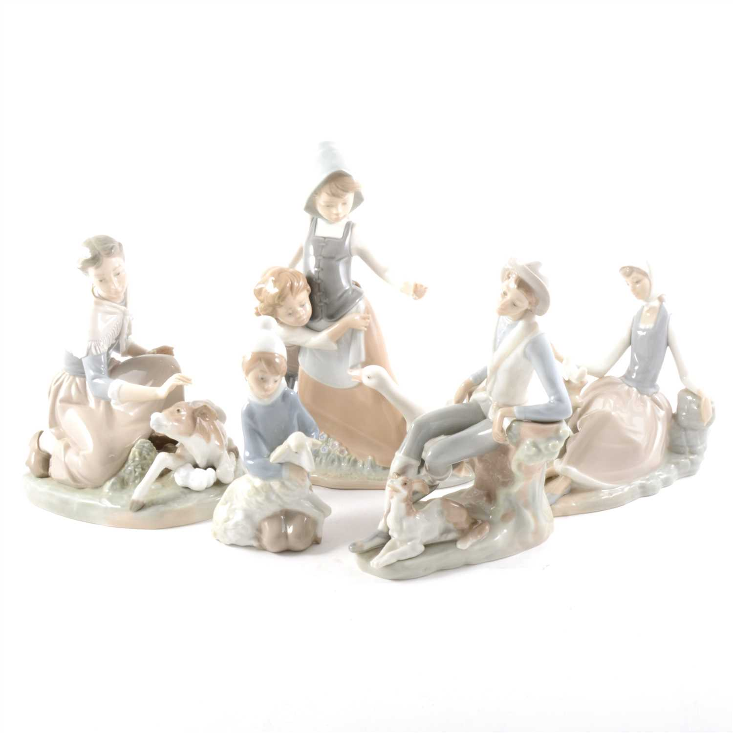 Lot 9-A Lladro figure, Milkmaid and Calf, and four other figures