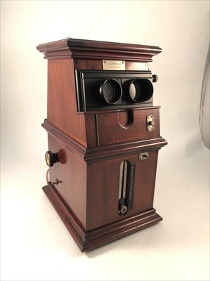Lot 542-French walnut cased Sterodrome viewer, L Gaumont & Cie, Paris, with collection of slides.
