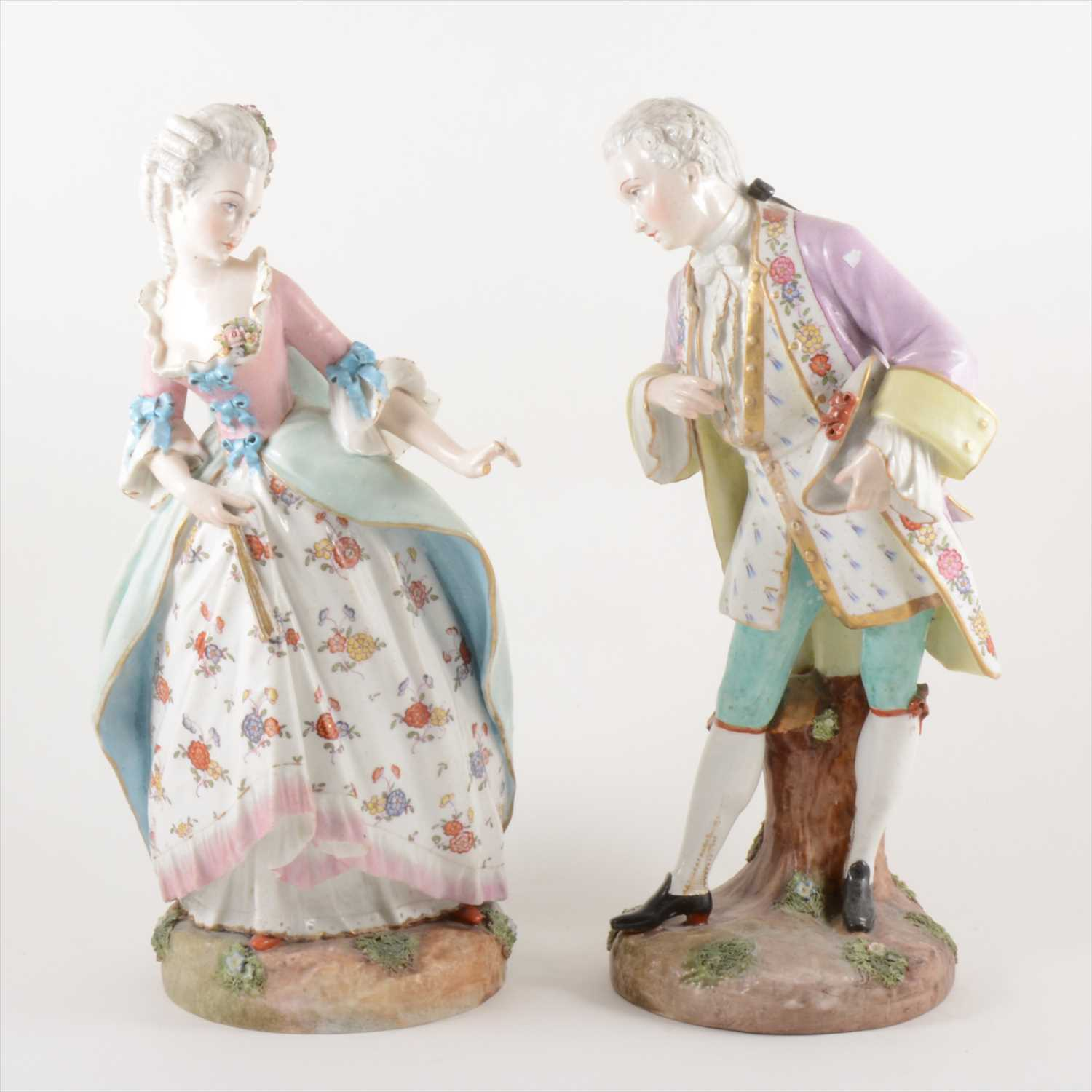 Lot 503-A pair of German porcelain figures, of a lady and gallant, Meissen Marcolini marks, 19th Century.
