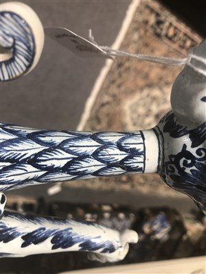 Lot 44-A Dutch Delft blue and white ewer, griffin head handle