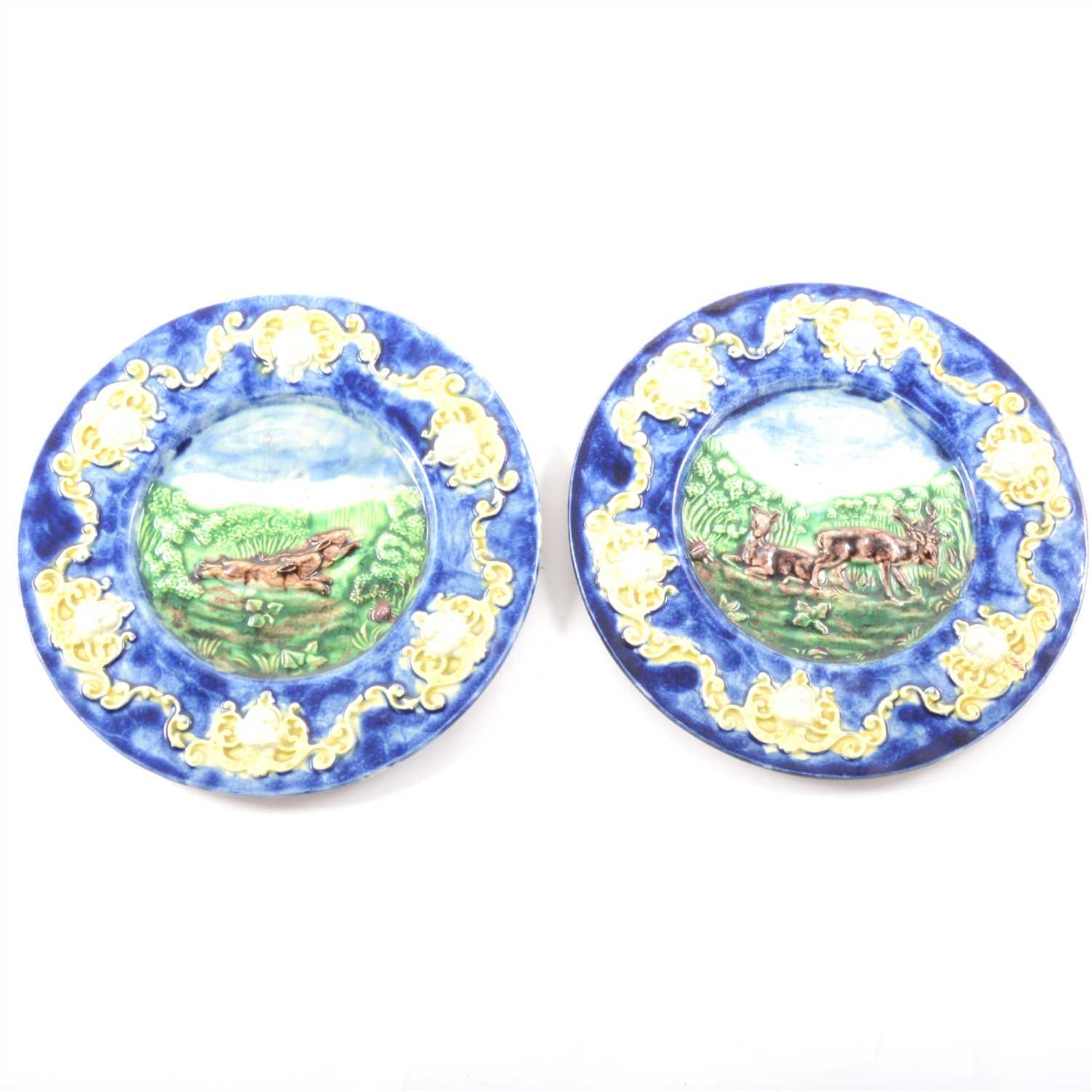 Lot 6-A pair of majolica plates, relief decorated with deer and hares
