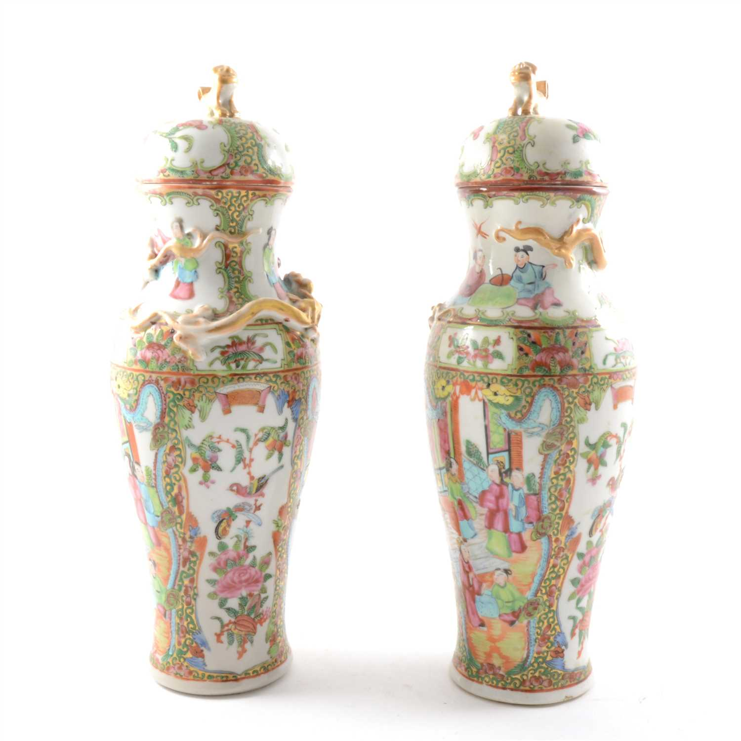 Lot 7-A pair of Cantonese porcelain baluster shape covered vases