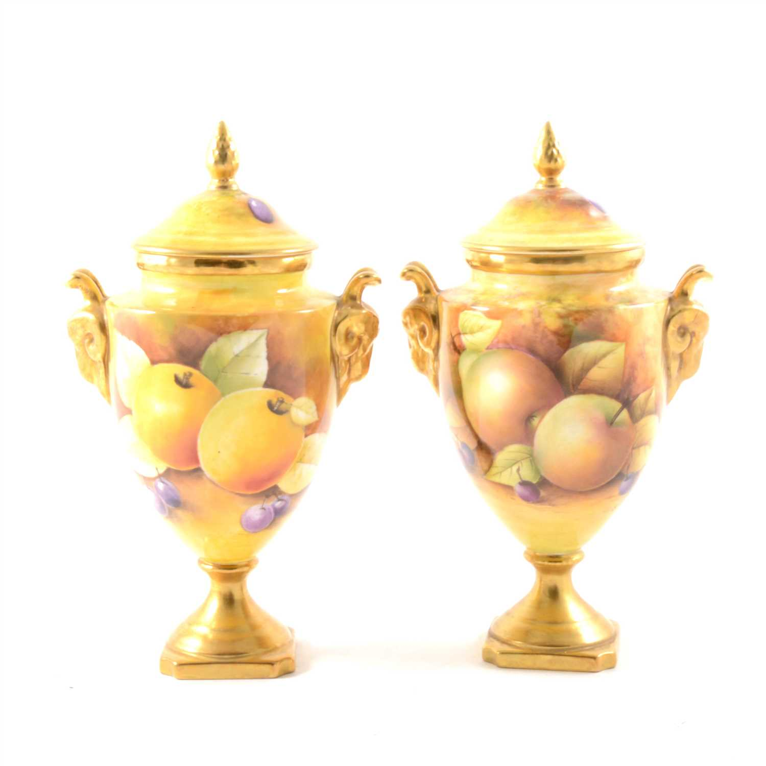 Lot 2-A matched pair of Coalport covered urns