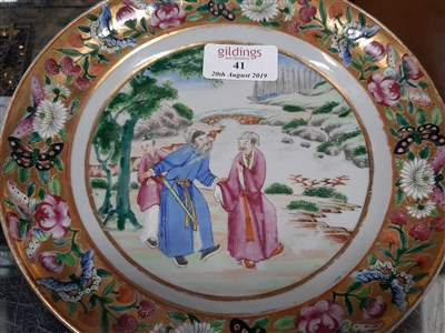 Lot 41-Chinese export porcelain plate, decorated with figures by a river