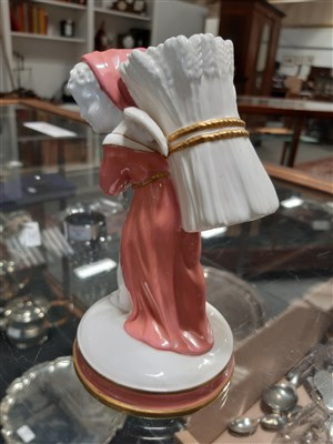 Lot 42-A Royal Doulton figure, Father Christmas, HN3399, and eleven other decorative figurines