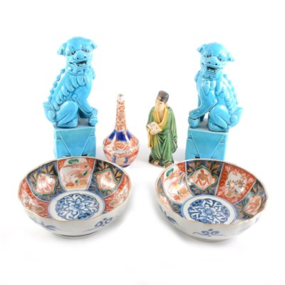 Lot 44-A pair of Chinese turquoise glazed models of Temple Lions, ...