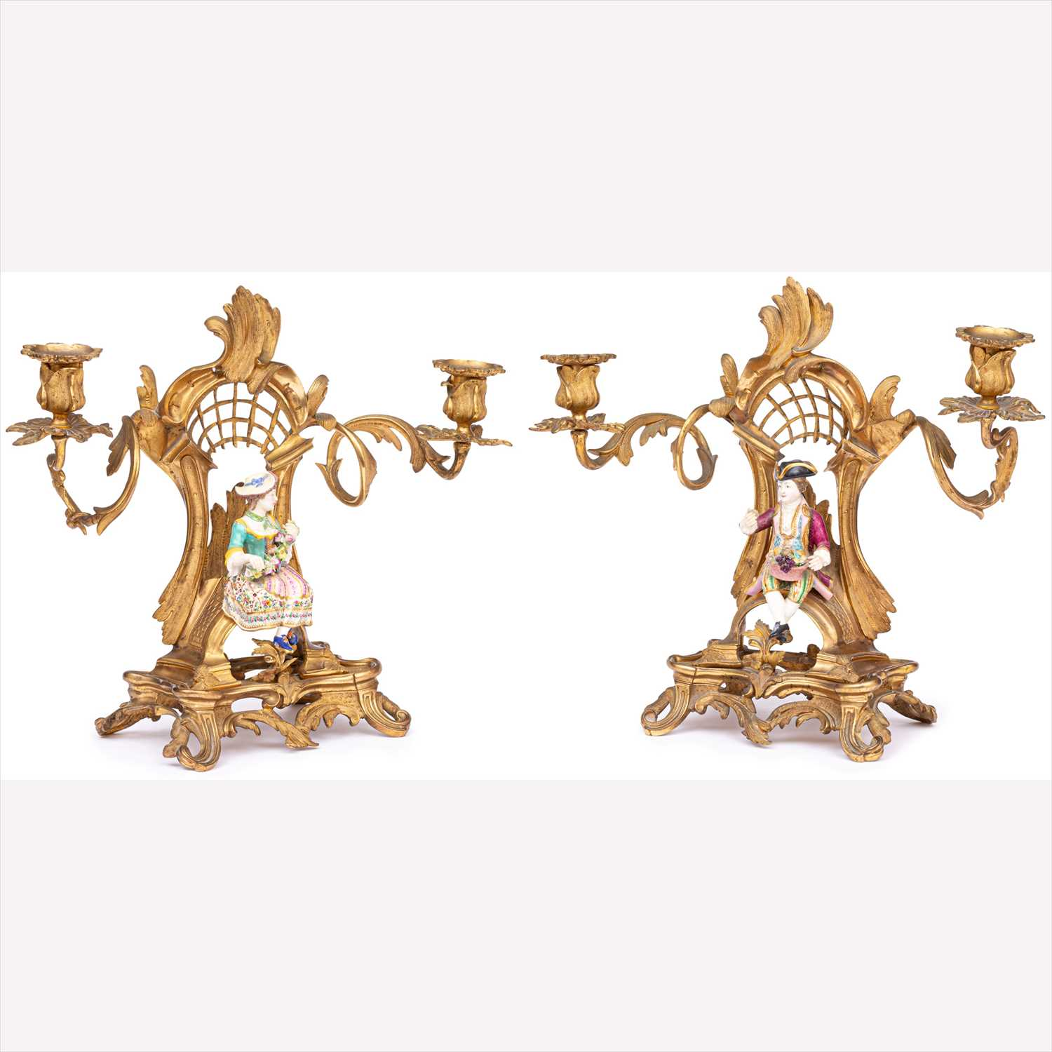 Lot 507-A pair of Rococo style gilt metal two-light candelabra