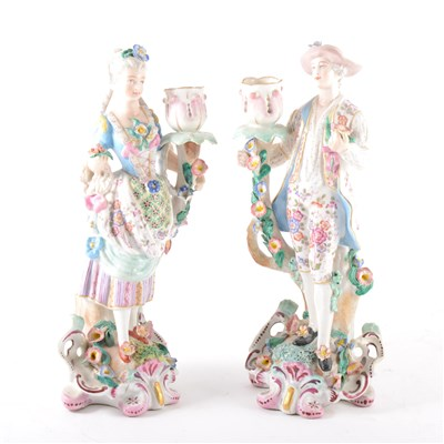 Lot 5-A pair of continental porcelain figural candlesticks, probably French, ...