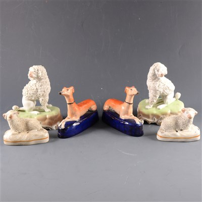 Lot 48-A pair of Dresden porcelain models of seated poodles, ...