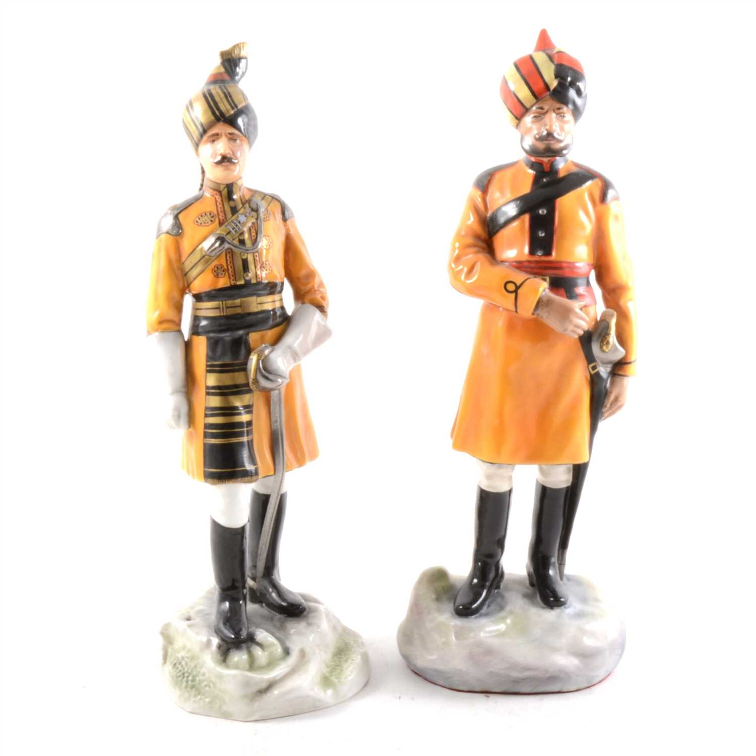 Lot 24-Two limited edition military porcelain figures by Michael Sutty