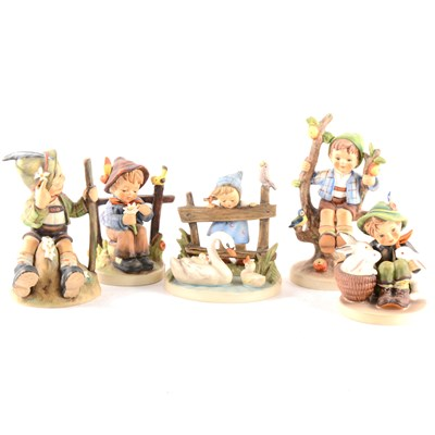 Lot 25-A collection of Hummel figurines, including Apple Tree, Boy and Girl, ...