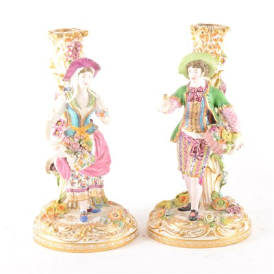 Lot 14-A pair of English porcelain candlesticks, in the style of Stevenson & Hancock