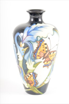Lot 49-A Butterfly and Iris design vase, by Moorcroft Pottery, 2007.