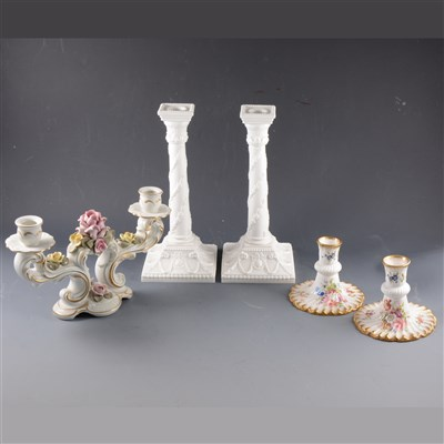 Lot 36-A pair of Royal Worcester plain white candlesticks, ...
