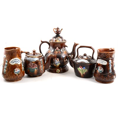 Lot 33-A collection of Measham pottery, including teapot and stand, small teapot, kettle and two milk jugs.