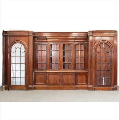 Lot 515-A large mahogany bookcase fascia, designed by Sir Edwin Lutyens for the Billiard Room of Papillon Hall