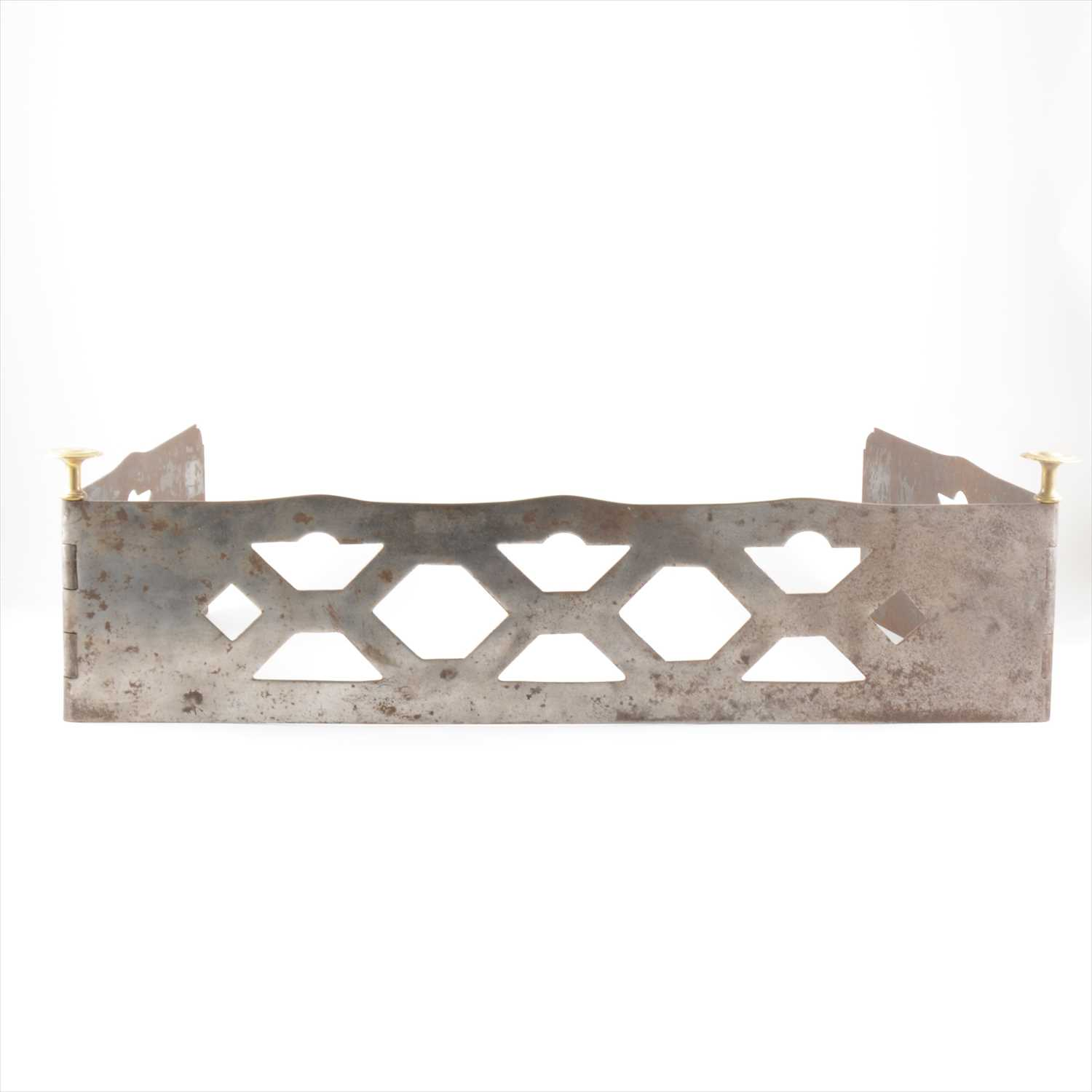 Lot 513-A cut steel and brass hinged fender, attributed to Sir Edwin Lutyens.