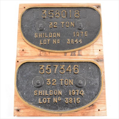 Lot 39A-Two cast iron railway plaques; 358018 32 ton Shildon 1975 lot no 3844, 28cm by 17cm, and a 357346 32 Ton Shildon 1974 lot no 3815, 28cm by 17cm, both mounted on wood.