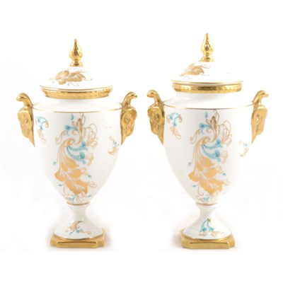Lot 14-Two pairs of Coalport 'Strange Orchid' pattern vases and covers.
