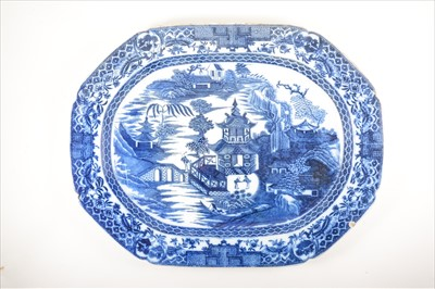 Lot 524-Four transferware Ironstone meat plates, 'Two Figures' pattern., circa 1800