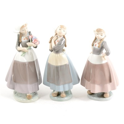 Lot 20-Three Lladro models Dutch Girls, one with tulips, ...