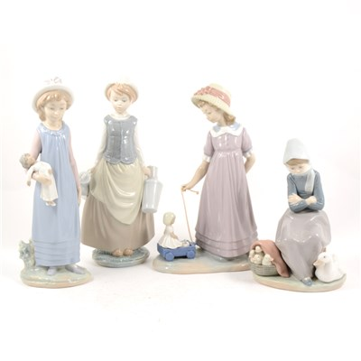 Lot 27-Four Lladro figures, Girl with a Doll, 59cm, ...