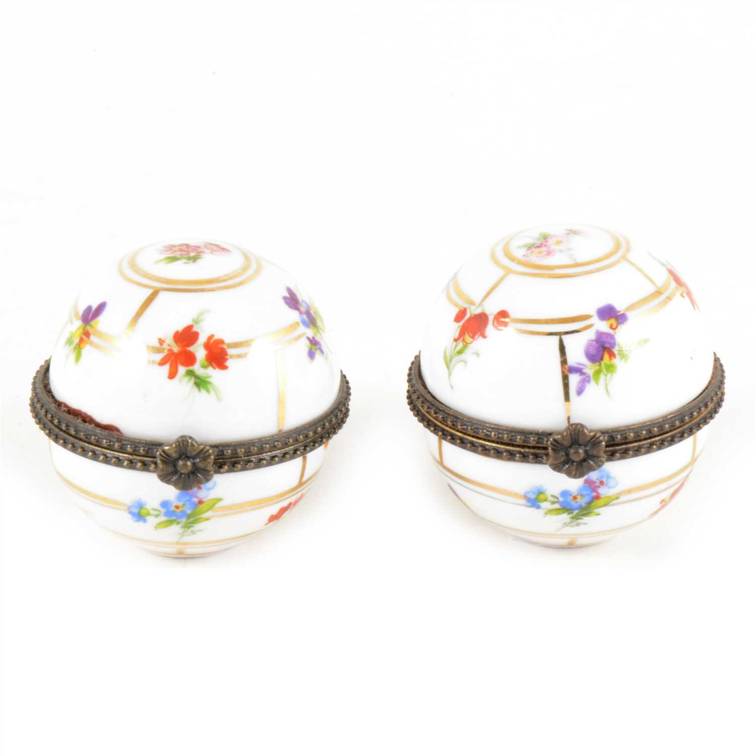 Lot 5-A pair of Continental porcelain trinket boxes with metal mounts.