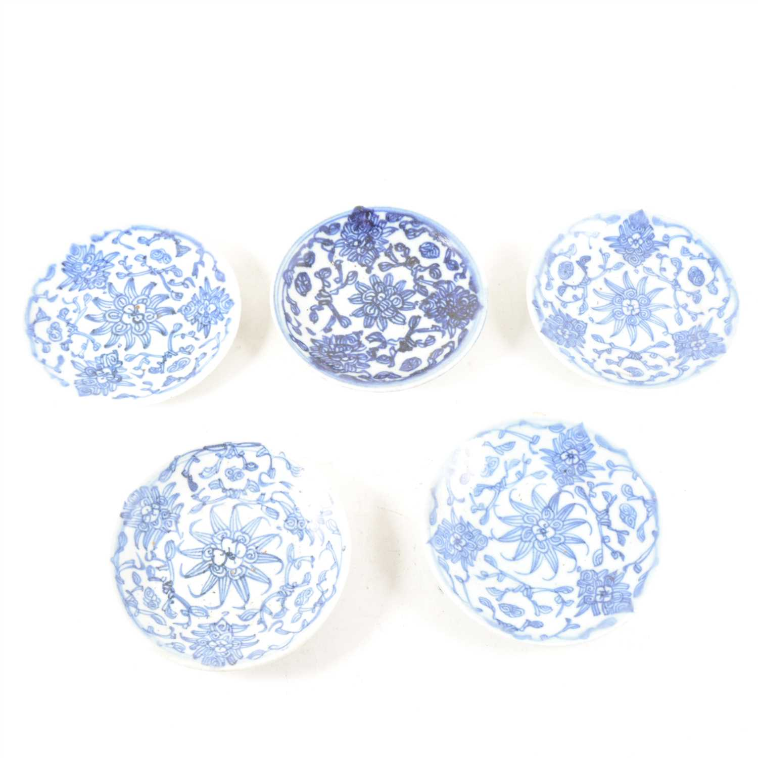 Lot 27-A collection of  Chinese Tongxi blue and white saucers, ...