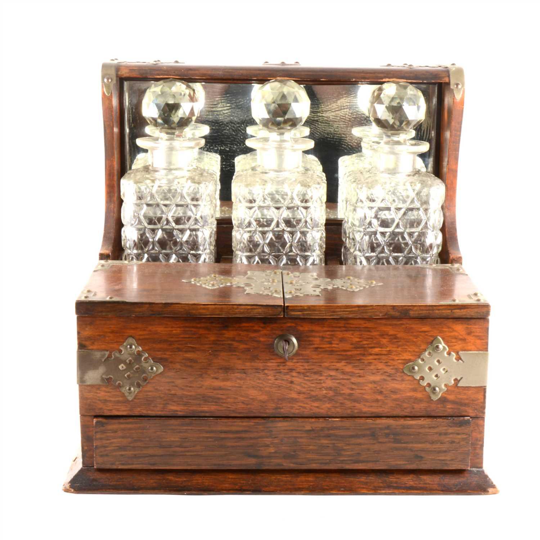 Lot 36-An Edwardian oak tantalus box