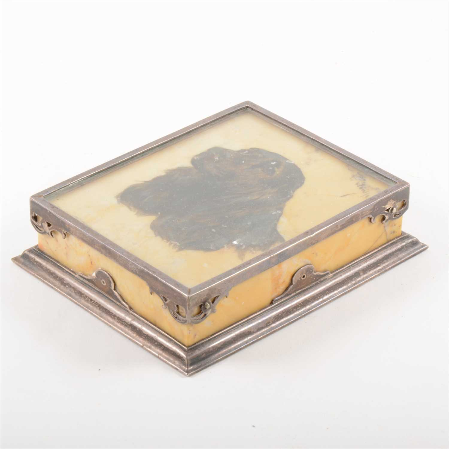 Lot 532-An Edwardian Sienna marble and white metal rectangular paperweight, signed Arthur Wardle.