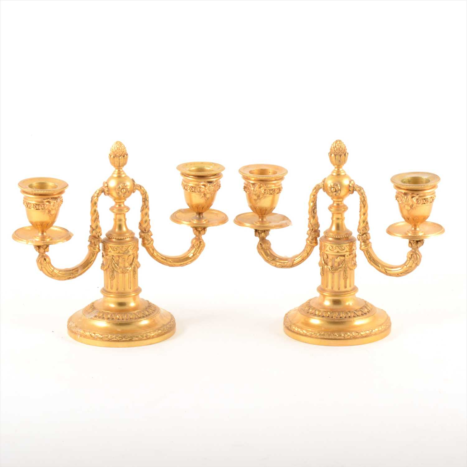 Lot 534-Pair of Louis XVI style gilt metal two-branch candelabra