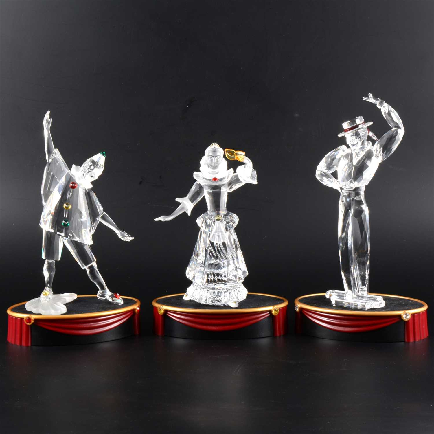 Lot 20-Two Swarovski 'Masquerade' limited edition figures, and another.