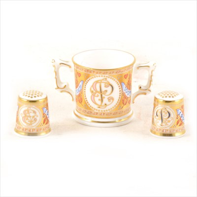 Lot 17-Royal Crown Derby miniature loving cup and two thimbles.