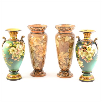 Lot 68-Two pairs of Doulton Faience ware vases, damaged