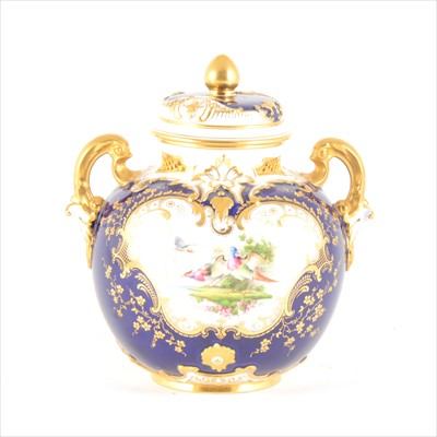 Lot 48-A Royal Worcester twin-handled vase and cover