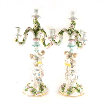 Lot 35-Pair of Continental porcelain four-light figural candelabra