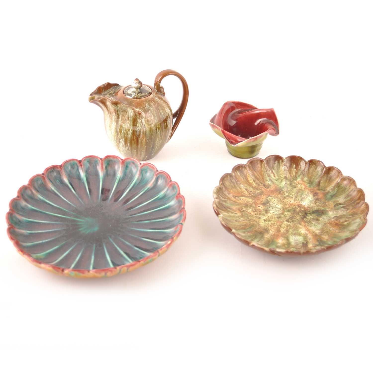 Lot 505-Two lobed dishes designed by Dr Christopher Dresser for Linthorpe Art Pottery, a Sea-form teapot, and another vase