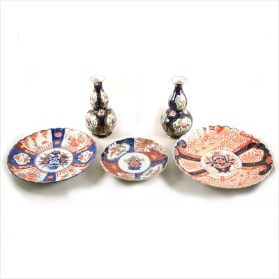 Lot 44-Three Imari-ware plates, plus a pair of double gourd shape vases.
