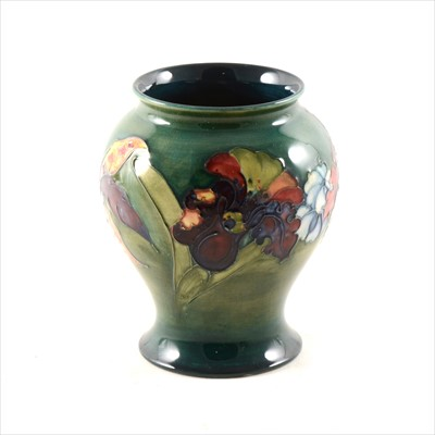 Lot 50-An 'Orchid' pattern vase by Moorcroft, circa 1960s