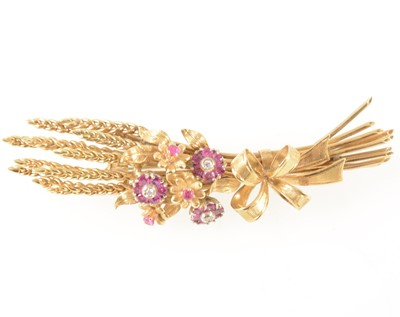 Lot 72-An 18 carat gold ruby and diamond brooch, in the form of sheaf of corn.