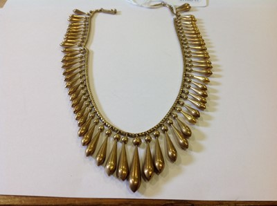 Lot 106-A late 19th Century yellow metal fringe necklace.