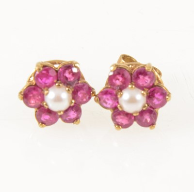 Lot 56-A pair of ruby and pearl cluster ear studs