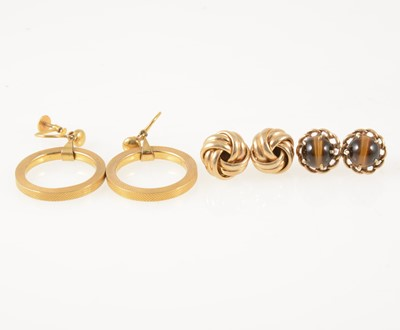 Lot 59-Three pairs of gold earrings.