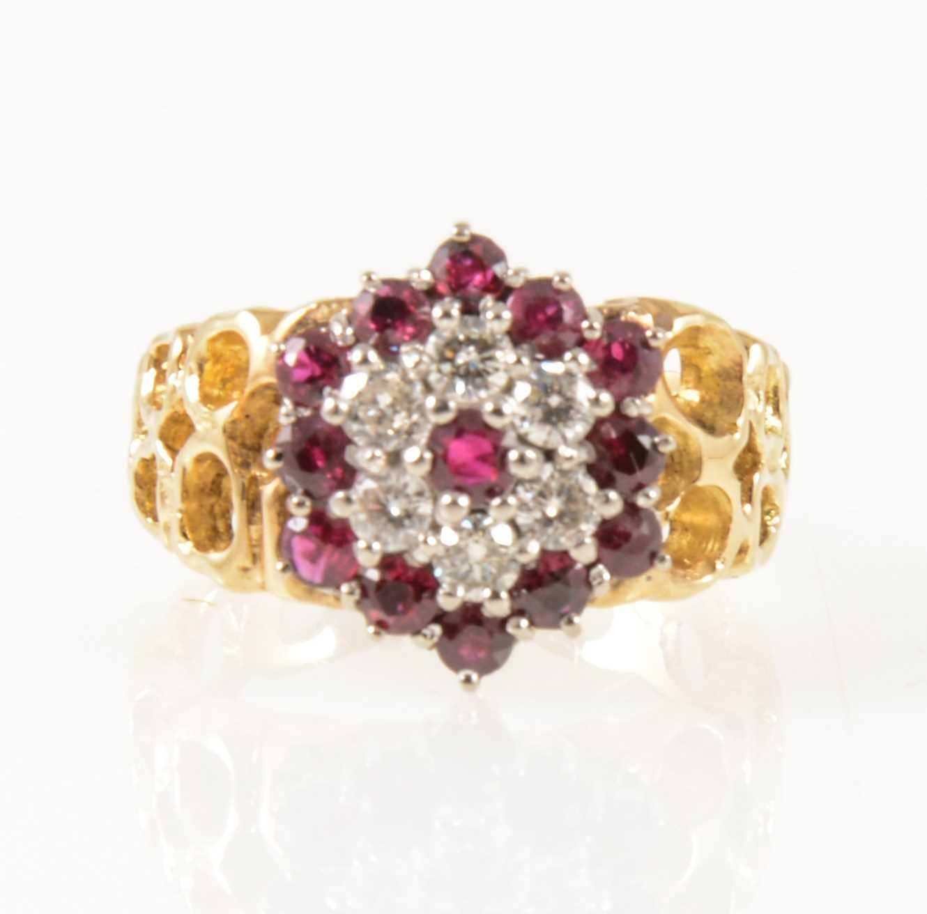 Lot 27-A vintage ruby and diamond circular cluster ring.