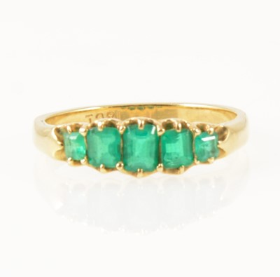 Lot 31-An emerald five stone half hop ring.