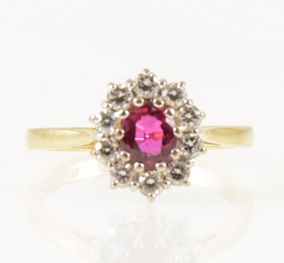 Lot 26-A ruby and diamond oval cluster ring.