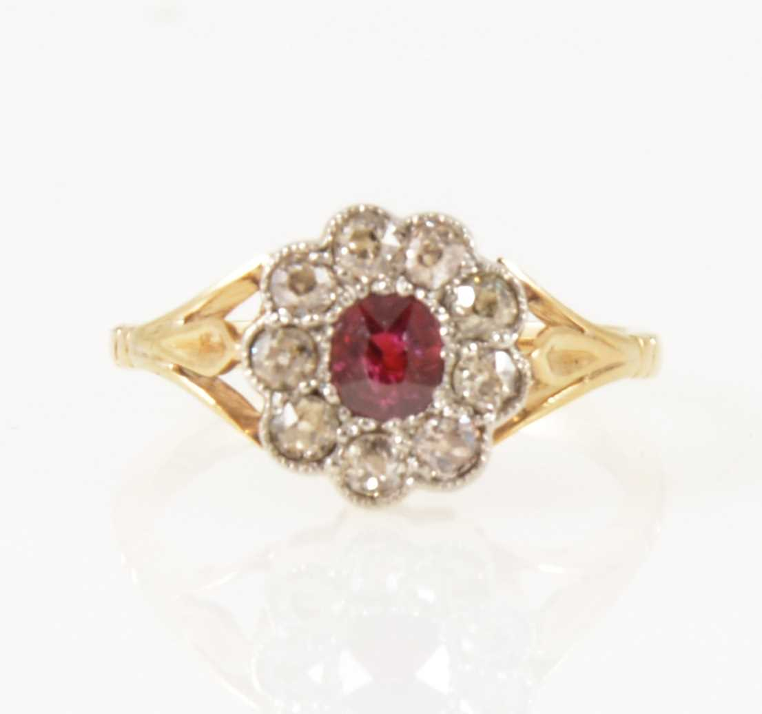 Lot 25-A ruby and diamond cluster ring.